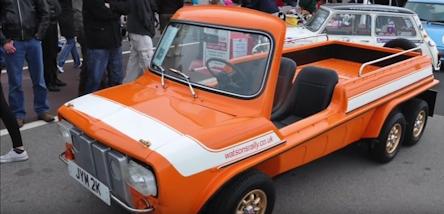 orange and white pickup vehicle