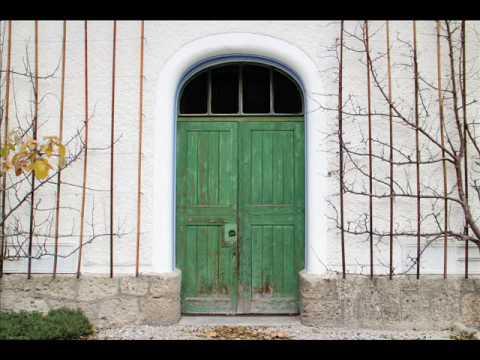 Green door in white wall