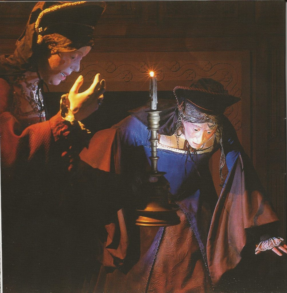 painting of two women looking down at the floor; one holding a candle