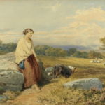 Woman seated alone on a rock