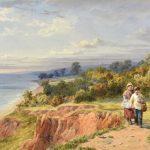 Boy and girl walking a dog